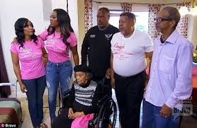 Image of Kenya Moore with her famliy